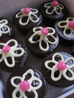 Cupcake Decorating Idea - simple flower decoration, using an M for the center.