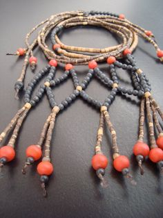 Wolf spirit. Native American inspired red glass, bone, wooden, black lava statement necklace