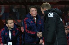 Manchester United boss Louis van Gaal shakes hands with Bournemouth manager Eddie Howe before the Premier League clash