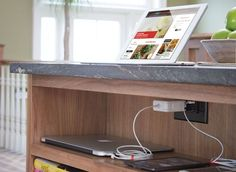 Incorporate a charging station into an island countertop,  or tuck it into an open cubby or cabinet drawer (made easier by electric outlets with built-in USB ports). There are also freestanding stations that can be kept out on the countertop, space permitting.