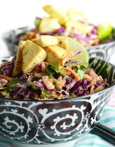 This delicious and healthy chopped salad with spicy peanut sauce is packed with vitamins and minerals and high in protein thanks to some crispy tofu. Vegan.