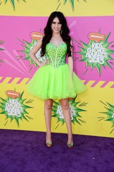 Teen Star Ryan Newman in neon Sherri Hill doll dress, available at MissesDressy.com. #neon #Prom #celebrity