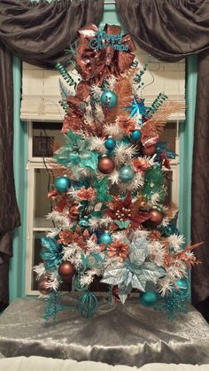 turquoise and copper christmas tree that i did for christmas 2013 teal