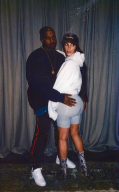 Kim K and Kanye/ HOW FREAKIN AKWARD IS THIS PHOTO? OH, THEY ARE SO MESSED UP! KANYE ALWAYS GOT HIS HANDS ALL OVER HER ~~~ WHATEVER THEY CALL IT...