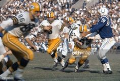 Gino Marchetti pursues Paul Hornung of Packers. (10-28-62, at Baltimore)