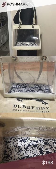 """Burberry PVC small tote Small Clear PVC with off white leather trim and silver hardware. Button feet on bottom. Has adorable white and blue floral print on inside bottom of background.  BURBERRY name heat stamped on front, auth tag inside and written in floral lining,double handle 10"""" W 81/2 """"T 4"""" D handles 8"""" Does have some slight color transfer marks on one corner. Will creat additional listing with pics. Please see it BEFORE purchasing!! otherwise no stains, rips, holes or damage. Does…"""