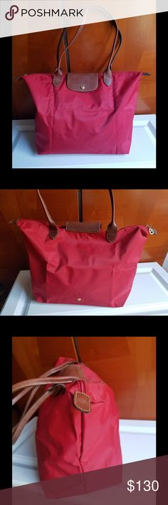 LONGCHAMP SHOPPING TOTE MODEL DEPOSE  BRIGHT RED Bright red large longchamp shopping tote   About  12 inch tall  when laying flat  about 18 inch wide  about 10 handle drop clean inside not lined   Few stains on outside  in front of purse  but toward bottom on right side  as shown on pict handles on top show some wear but not much Longchamp Bags Totes
