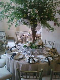 Wedding for work at Westchester country club. Orchids, viburnum and mock orange branches.
