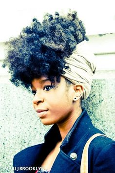 Braid out updo wrapped up in scarf with a bang,