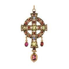 Pendant by Percossi Papi: Silver gilt, Cloisonné enamel, garnet, peridot and sapphire.