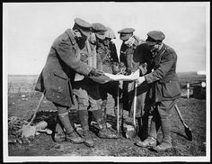 British officers studying a map    http://www.flickr.com/photos/nlscotland/4688574550/in/photostream/