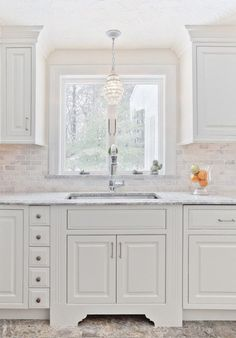 White Kitchen traditional kitchen: The countertop is Supreme White granite. it looks like marble but does not have the maintenance issues. Backsplash is Carrara Marble Classic Kitchen, All White Kitchen, Rustic Kitchen, New Kitchen, Kitchen Ideas, Kitchen Tables, Kitchen Photos, Updated Kitchen, Design Kitchen