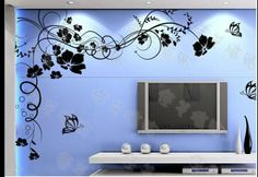 Vinilo decorativo de motivos florales simulando una rama con flores. Fabricado en color negro quedará ideal en tu salón.