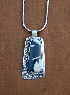 Chinese Writing Stone Necklace by Susan Tobey. Love the way she treated the bezel and how the stone is off-center.