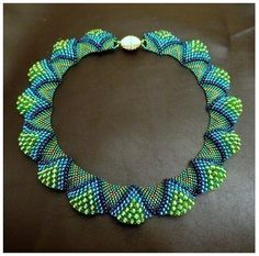 Instructions for this lovely necklace on labhouseshold, no artist attribution that I can find.