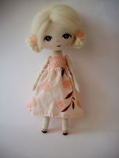 Beautiful cloth doll,perfect for decoration or gentle playing.about 28 high.  Stuffed with holofiber, hand painted.  Used materials-cotton fabrics,