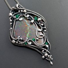 Double-sided pendant of fine silver wire, sterling silver and emerald beads, and Boulder opal, by Sarah Thompson - Sarah-n-Dippity on Etsy.