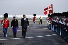 Inspecting the troops: The Dutch royals inspected their Danish honour guard before leaving the airport