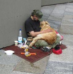 homeless man holds his treasure