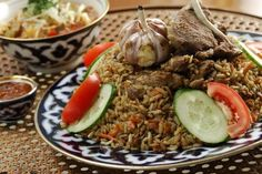 Plov is a cult dish not only in its homeland Uzbekistan, but all over the former Soviet Republics and Russia. A hearty one-pot rice dish cooked in lamb fat with onions and carrots, it has many variations.   Here is Plov recipe just as it is cooked in Uzbekistan.