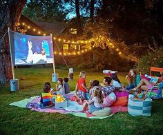 Pass the popcorn! Learn how to host a blockbuster backyard bash, complete with movie trivia, popcorn bar, and a Hollywood-sized screen. outdoor fun Summer Movie Night in Your Backyard Backyard Movie Nights, Outdoor Movie Nights, Outdoor Movie Party, Backyard Movie Party, Outdoor Parties, Kids Movie Party, Movie Theater Party, Cinema Party, Backyard Parties