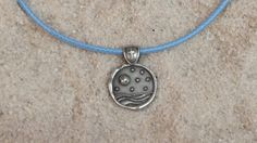 """A Baby Blue smaller version of """"He Hung The Moon & Stars"""" ladies pendant with blue cord"""