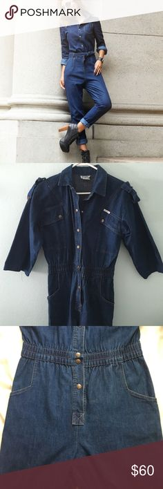 """Vintage denim jumpsuit coveralls Vintage denim coverall jumpsuit one piece. Size M.  Inseam 28"""". Waist measures 14"""" across laying flat. From neck to bottom of leg it measures 59"""". Brand is Dreams from the 1980s. Cinched waist with buttons all the way down. Has pockets on hips and on chest. Actual jumpsuit shown in last 3 pictures. It is similar to the cover shot. Vintage Pants"""