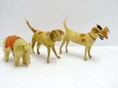 Three Spun Cotton Christmas Animals... An elephant and two dogs....one with a duck in its mouth.
