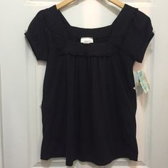 Belle du Jour Black Knit Top NWT Black knit top from Belle du Jour. New with tags. Great alternative to a regular t-shirt. Square neck opening with Ruffles accents and a slight poof in sleeves. 100% cotton. Size Medium. Belle du Jour Tops Tees - Short Sleeve