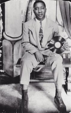 Muddy Waters (1913-1983) holding his first recording, 1940's.