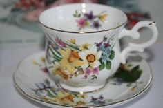 St. James teacup and saucer with daffodils, irises and forget me nots
