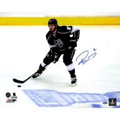 Drew Doughty Signed Los Angeles Kings Skating by 2014 Stanley Cup Logo on Ice 16x20 Photo - Kings Star Drew Doughty has personally hand-signed this 16x20 Skating by 2014 Stanley Cup Logo on Ice Photo-Coming off recently winning the 2014 Stanley Cup Finals against the New York Rangers this young defencemen has no doubt been a huge component in the Kings success. Making his NHL debut at that young age of 18 he was named to the All-Rookie Team. He is also a two time Stanley Cup Champion which…