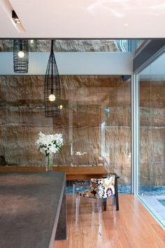 by Bruce Stafford great idea. rammed earth wall behind glass makes it an art statement