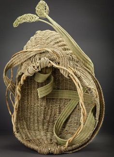 ''Emergence'' Rib Construction Basket by Heather Martin-McNab. who spent time in a remote village learning the traditional coiled methods of wrapping & stitching dyed grass over a straw core, using needles made from broken umbrella parts / http://www.saltspringbasketry.com