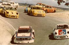 A BMW CSL and a whole bunch of 911s drop down into the corkscrew at Laguna Seca!