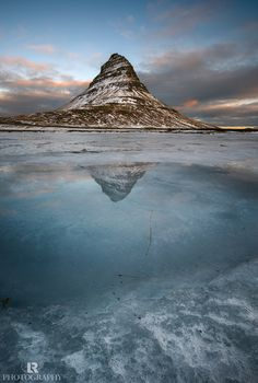 Parallel Worlds - While hanging around to find something original to shoot, not an easy job in over photographed places like this one, I found this small water pond over the frozen surface of the fjord reflecting the top of Kirkjufell that looked like a window into a parallel world.