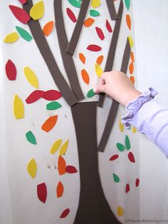 Make a cute fall tree with a contact paper background and some construction paper leaves!