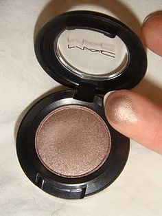 MAC Cosmetic's Satin Taupe eyeshadow: the first MAC eyeshadow I ever bought at 16 and many used pans later, my favorite still to this day