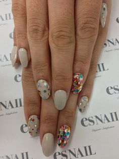 When you think sequins can only appear on dresses then you need to guess again. This wild and colorful sequin inspired nail art will totally blow your mind away! There's no need for complicated painted designs since a plain base will do and the sequins will complete the look for you!