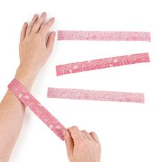 "Every cowgirl needs a few of these! What a great way for a bachelorette party to stick together! These Cowgirl Bandana Slap Bracelets can be used by any cowgirl. Perfect for birthday party favors, even as a part of your shower! Just slap these on and get ready to ride 'em cowgirl! Polyester. 9"" © OTC"