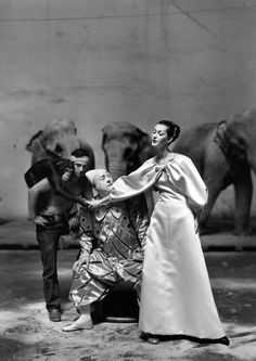 Dovima with Emilien Bouglione & clown in  Givenchy, 1955 Cirque D´Hiver. By Avedon.