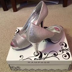 GRACEE Silver Sparkle Heels Slightly worn for prom and pageant. Still have the box and wrapping. Has little scratches in the front. The picture listed with that scratch is the worst one on the shoe. Rampage Shoes Heels