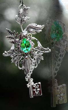 Key pendant with green stone.