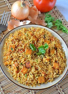 Day 5 of Blogging marathon and today's recipe is very nutritious n protein packed lunch box recipe. Rice looks like a rich biryani/pulao but it takes only 10-15 minutes to prepare this yummy n healthy rice. I started replacing paneer with Tofu. Tried so many recipes like curry/stir fry/pulao etc with tofu in place of paneer. My kids not able to find the difference between tofu n paneer , they know only paneer n started loving tofu :)) I simply stir fried the