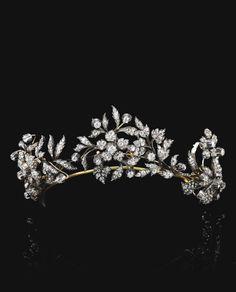 Diamond tiara formerly in the collection of Countess Costanza Pasolini Zanelli Magnaguti. Designed as three floral sprays, set with cushion-shaped, circular-cut and rose diamonds, each spray is detachable and may be worn as a brooch. Royal Crowns, Royal Tiaras, Tiaras And Crowns, Royal Jewelry, Fine Jewelry, Antique Jewelry, Vintage Jewelry, Faberge Eier, Bijoux Art Nouveau
