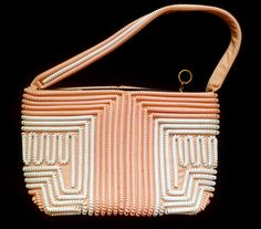"1940s pink and white plastic coil ""telephone cord"" purse"