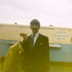 Ringo changing into his Walrus jacket in 1967