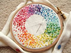 So simple, lots of french knots in rainbow hues. Could be done with leftover thread?