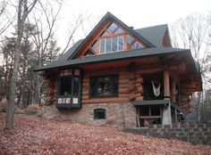Today's charmer features round logs and full-scribe joinery. See more exteriors from Tamarack log and Timber Homes.