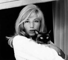Italian actress Monica Vitti holding a Siamese cat in her arms in the film High Infidelity. 1964 (Photo by Mondadori Portfolio via Getty Images)